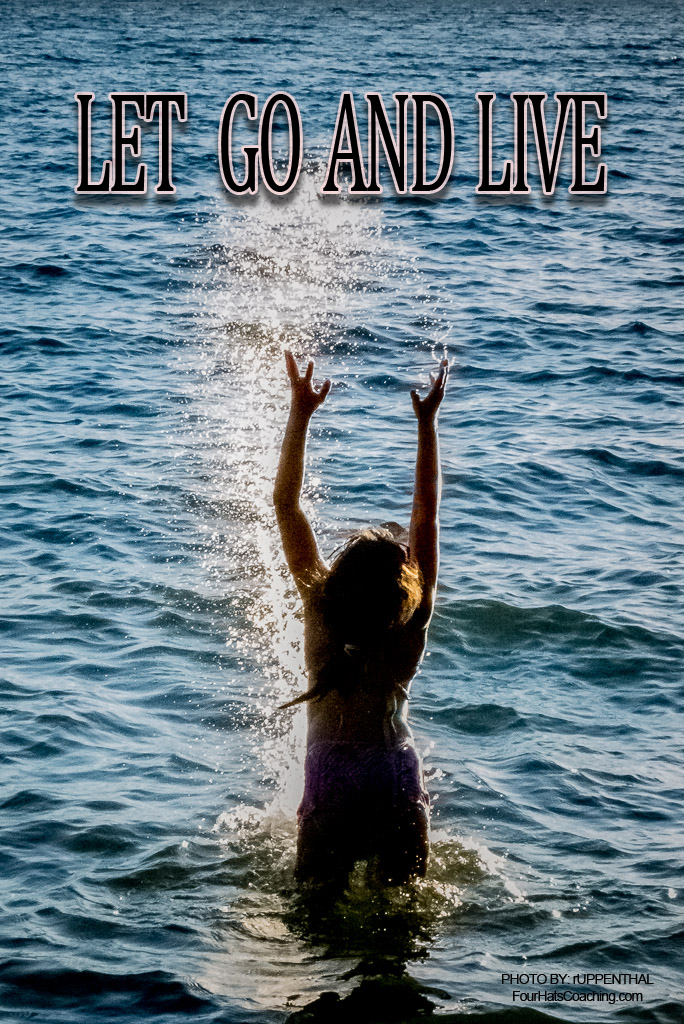 Child jumping out of the water, hands out stretched above her with the caption, Let go and live