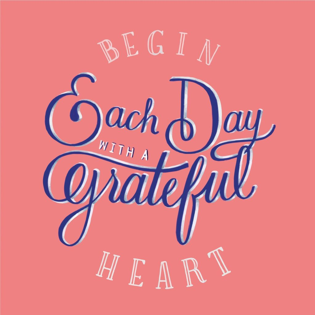 pink sign with the words Begin each day with a grateful heart.